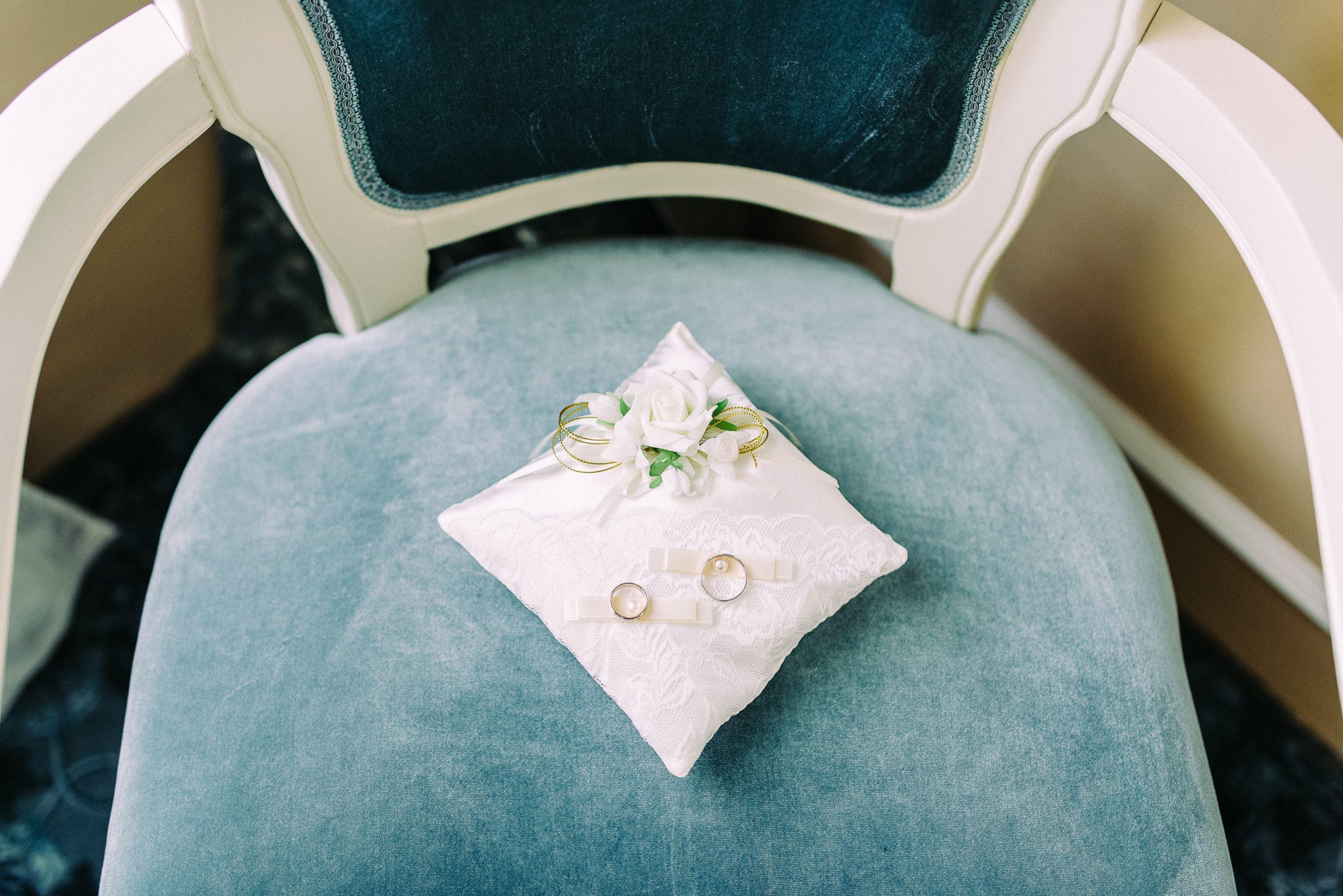 white-pillow-on-white-wooden-armchair-1676128