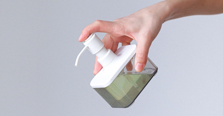 woman-applying-hand-sanitizer-3987142